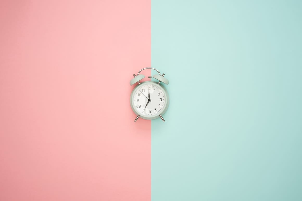 A clock on two diffeerent backgrounds. Homeschooling and working full time