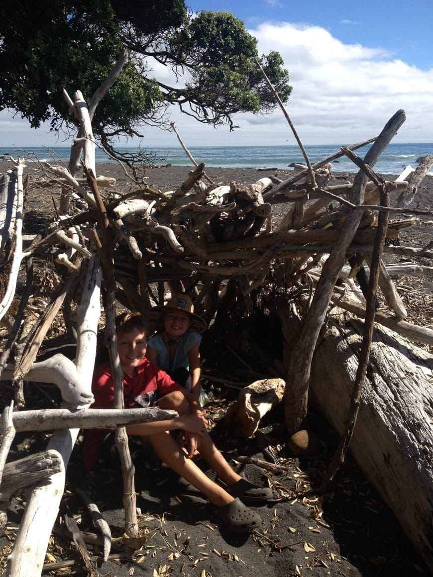 Homeschooling in a driftwood hut made on the beach