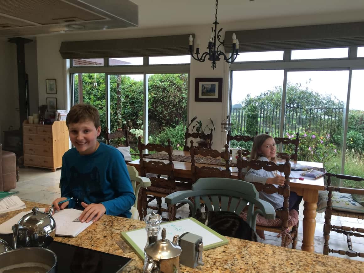 Two children doing their work while homeschooling