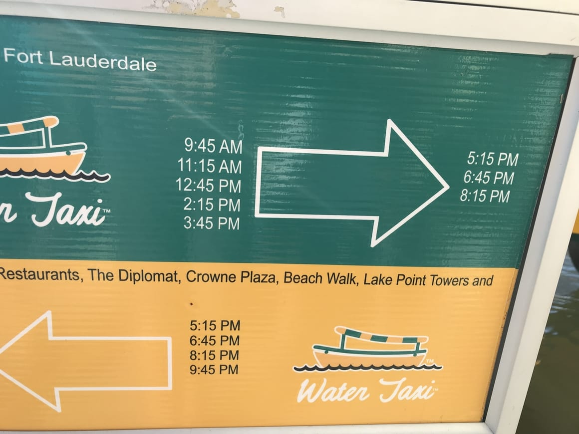 Ft Lauderdale water taxi sign saying the times of departure.