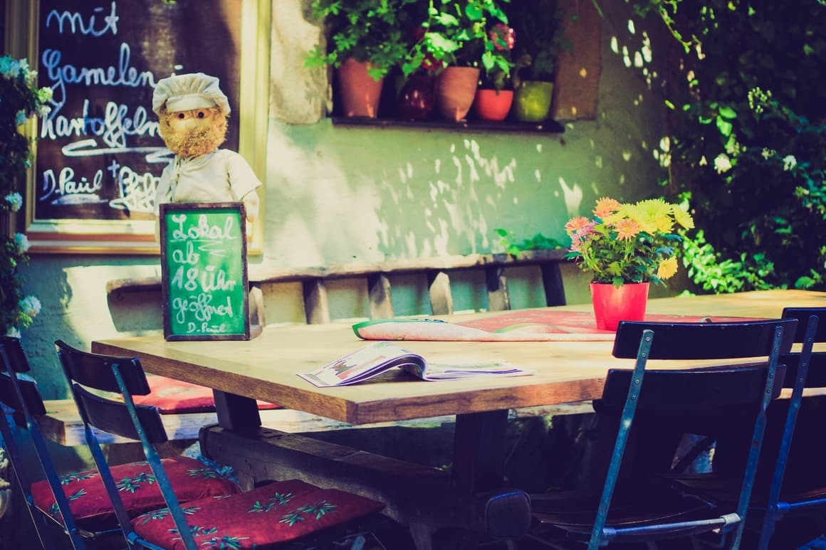 A European table and chair.A post about the best European cities to take your kids