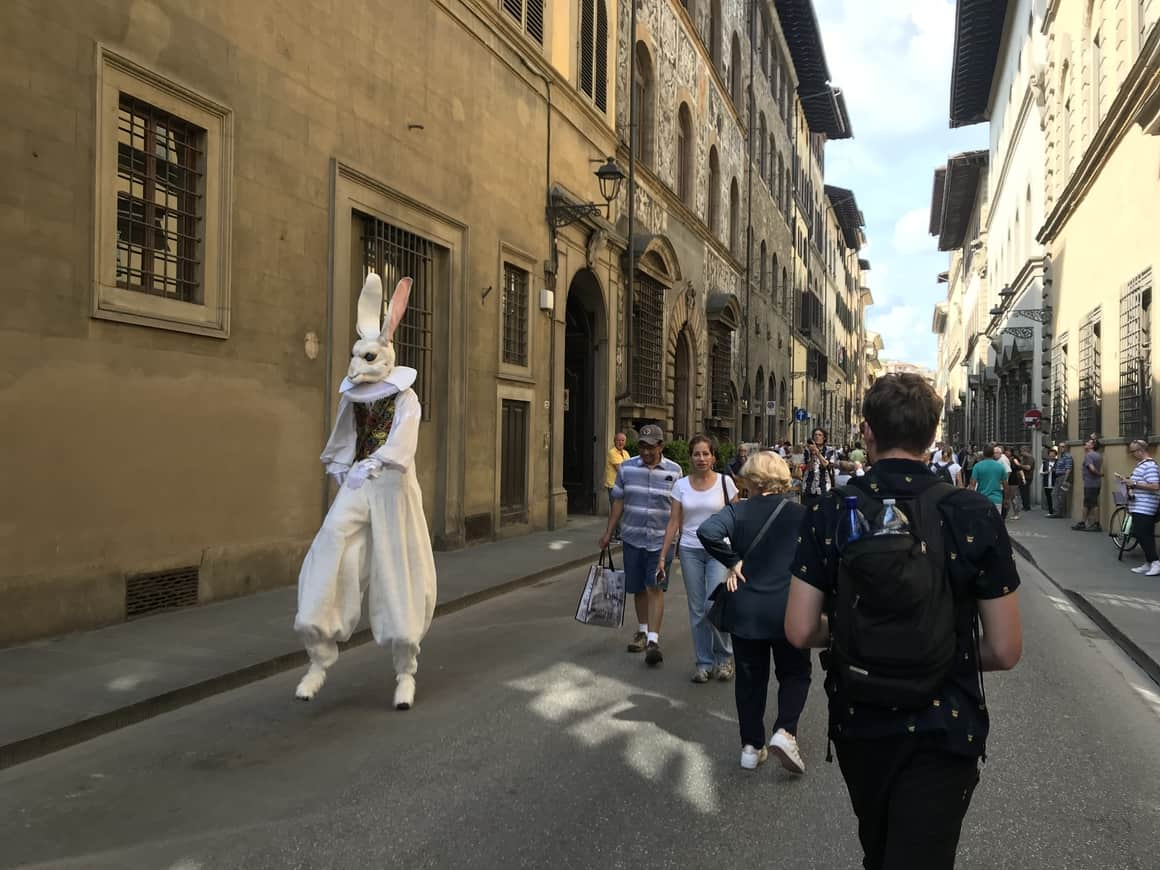 A man dressed in a large white rabbit suit in Florence. Perfect for kids