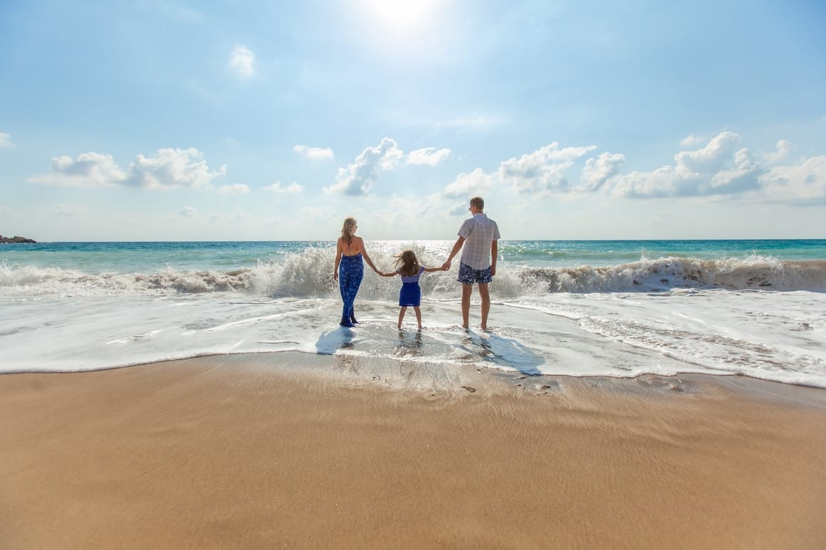 family on a beach. Best travel gifts for kids