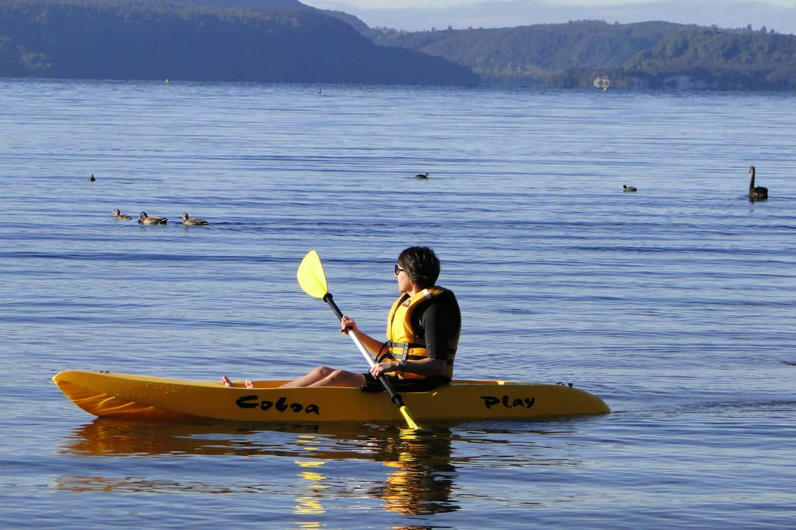 Woman in a kayak in new Zealand