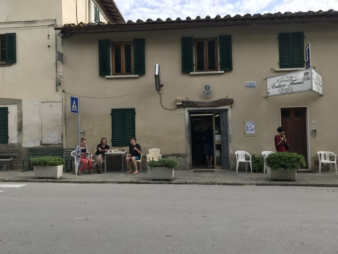A family eating at a cafe in Italy. Italy tips on how to get the best coffee in Italy