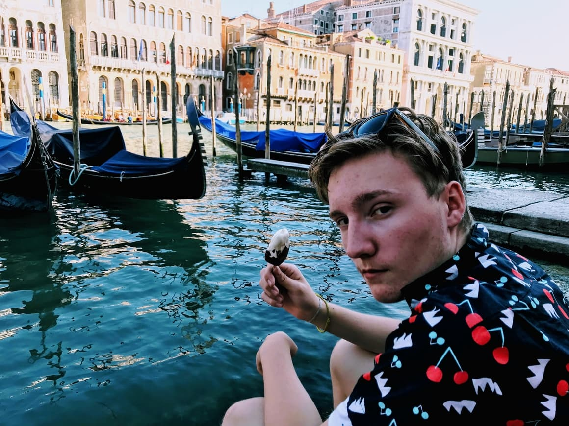 A boy eating Ice cream in Venice. Tips on how to save money in Italy