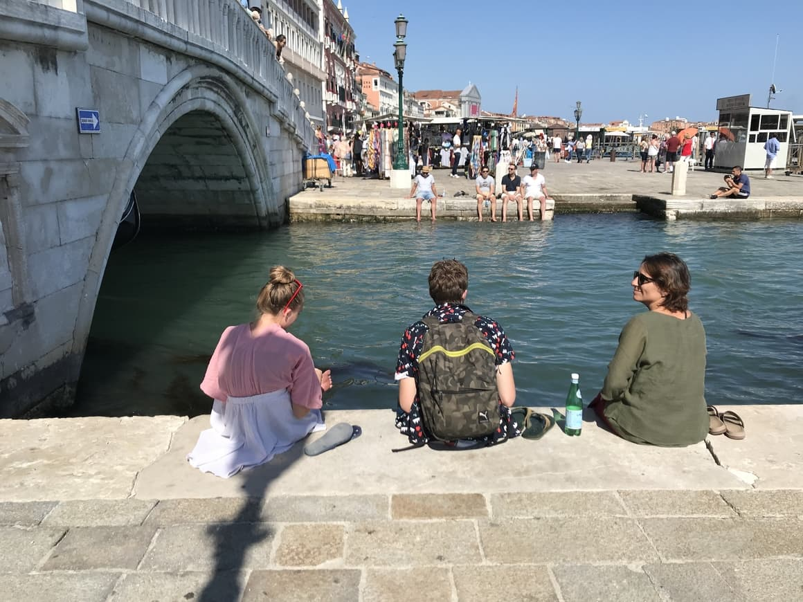 A family in Venice. Travel tips in Italy