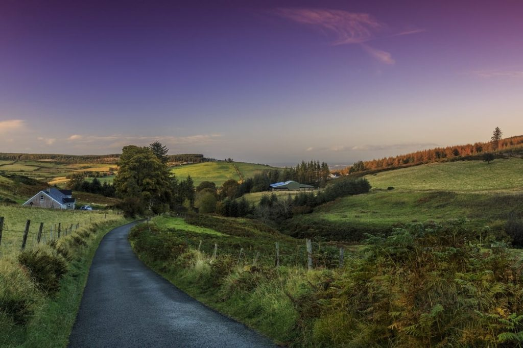 Irish windy road in beautiful countryside. Ireland travel tips