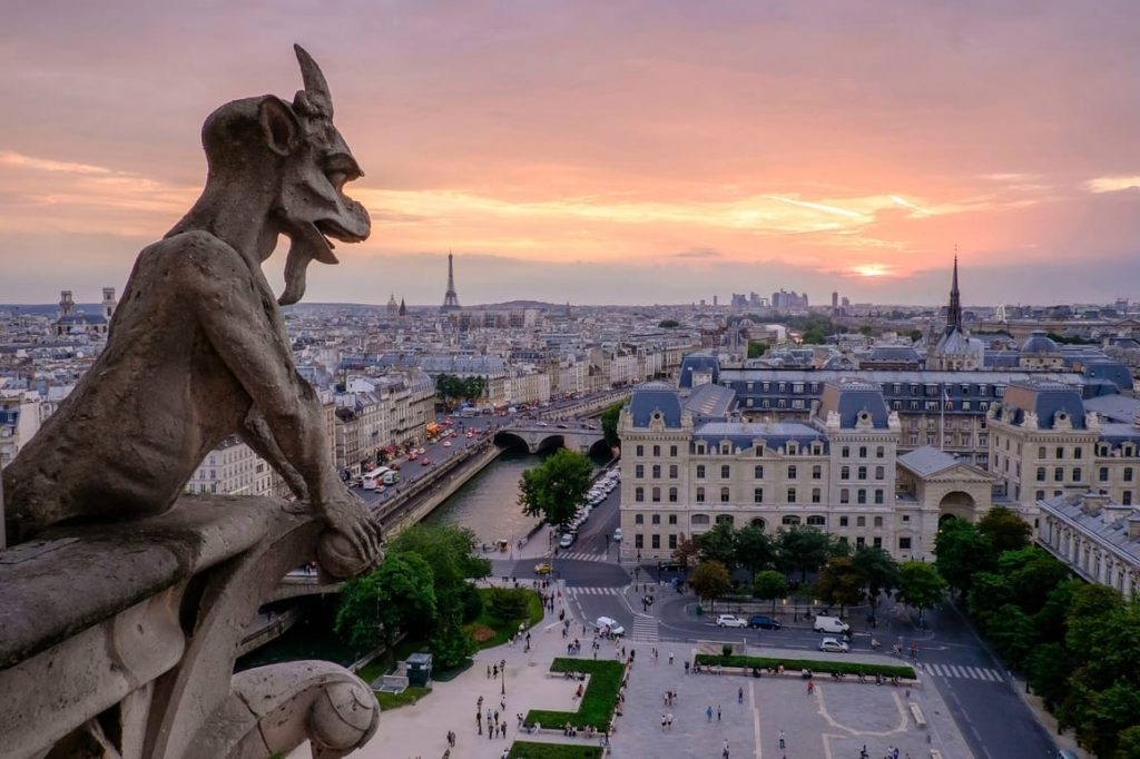 Paris sunset. A gargoyle looking over the city