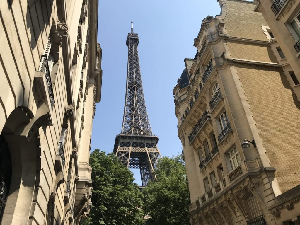 View of the Eiffel Tower from a side street in Paris.