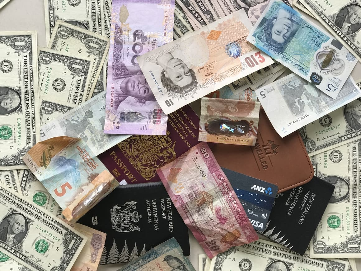 Currency notes and passports. The ultimate travel checklist