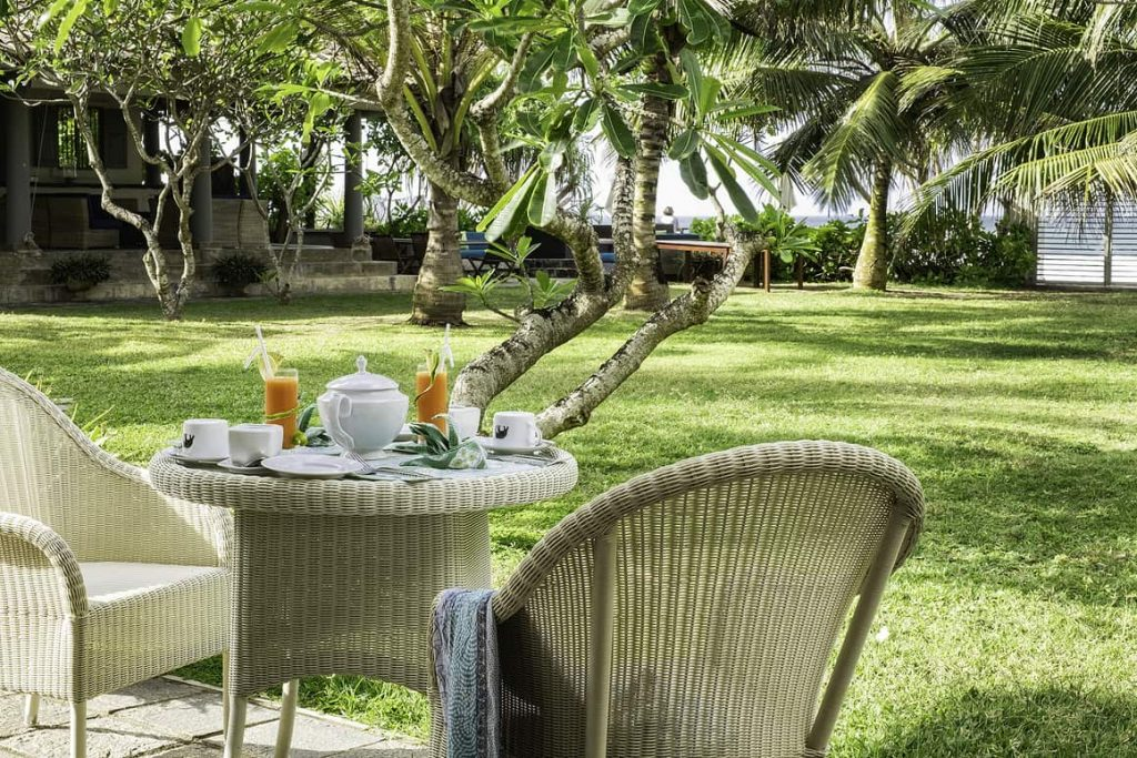 Table laid fro breakfast in the lush gardens of Sri lanka villa