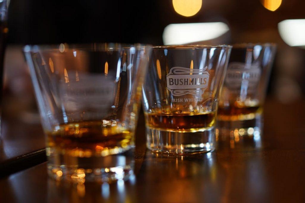 three glasses of Irish whiskey in a pub