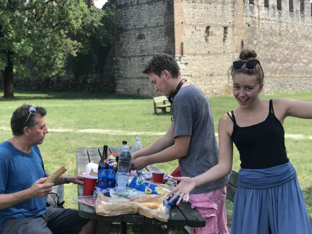 Family having a picnic in Italy