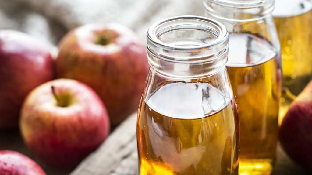 Apple Cider Vinegar and a plate of apples