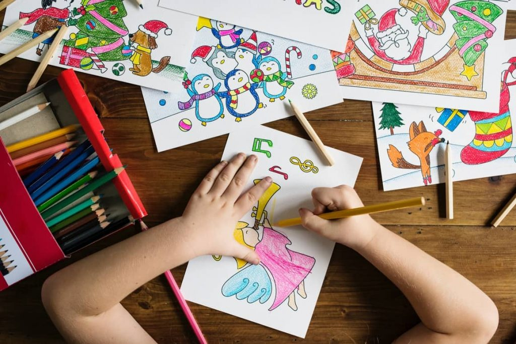 A child drawing a picture. Homeschooling vs public school