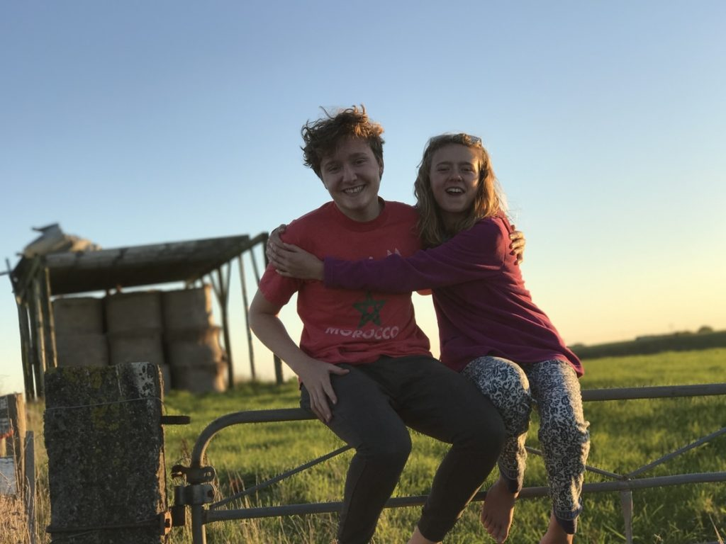 Brother and sister on fence. Homeschooling in New zealand