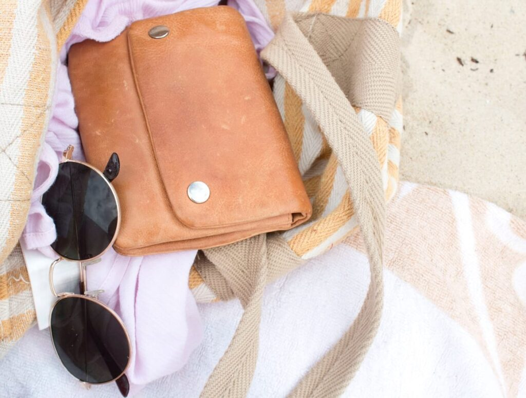 Travel purse with sunglasses ready for vacation