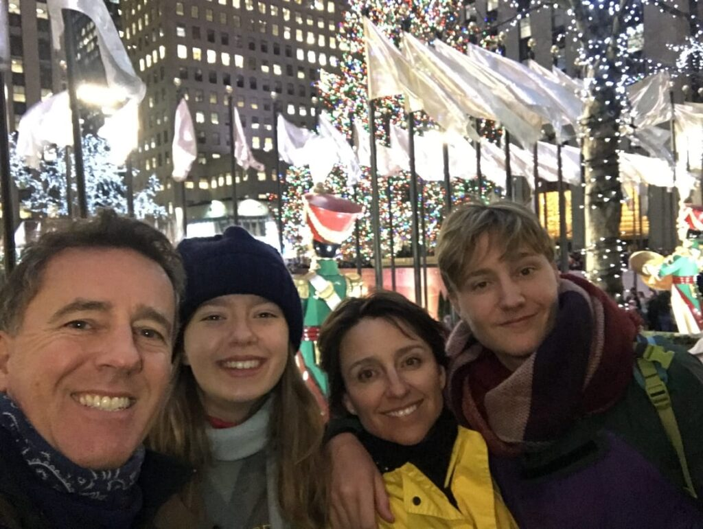 Family at the Rockefellar Centre in NYC at Christmas