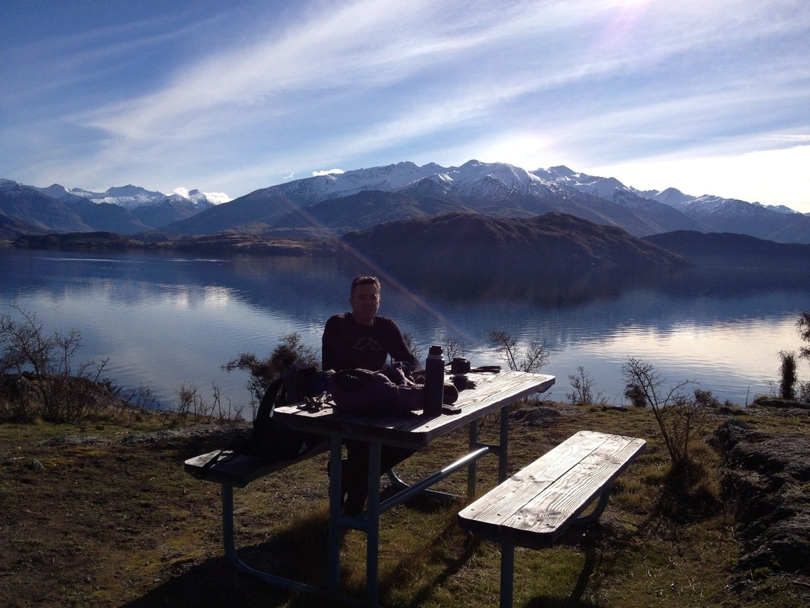 Man at a picnic table in winter in new Zealand