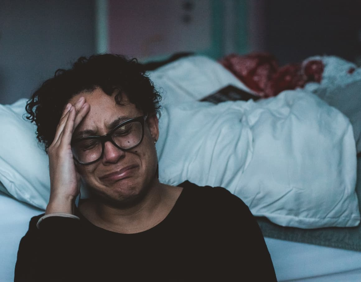 Woman crying becasue her homeschooling schedule is too strict