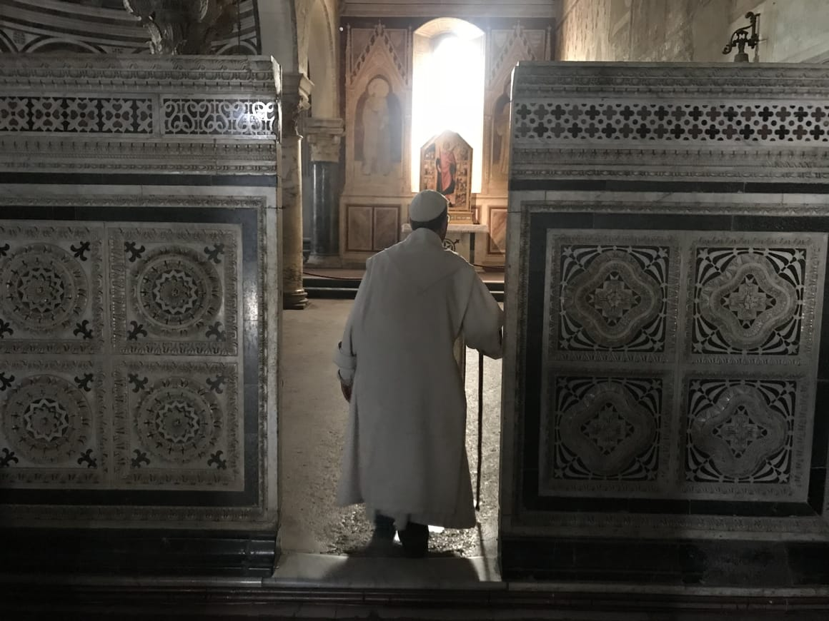 Priest in a church in Florence, Italy