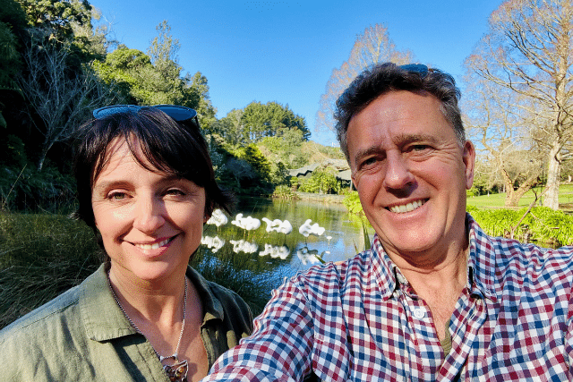 A husband a wife in a park in New Zealand talking about life skills