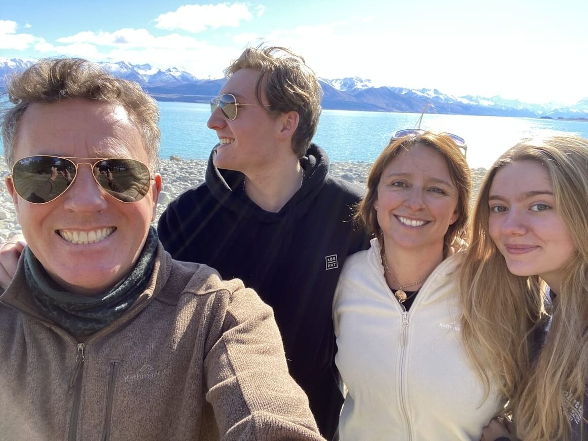 Family smiling in New Zealand
