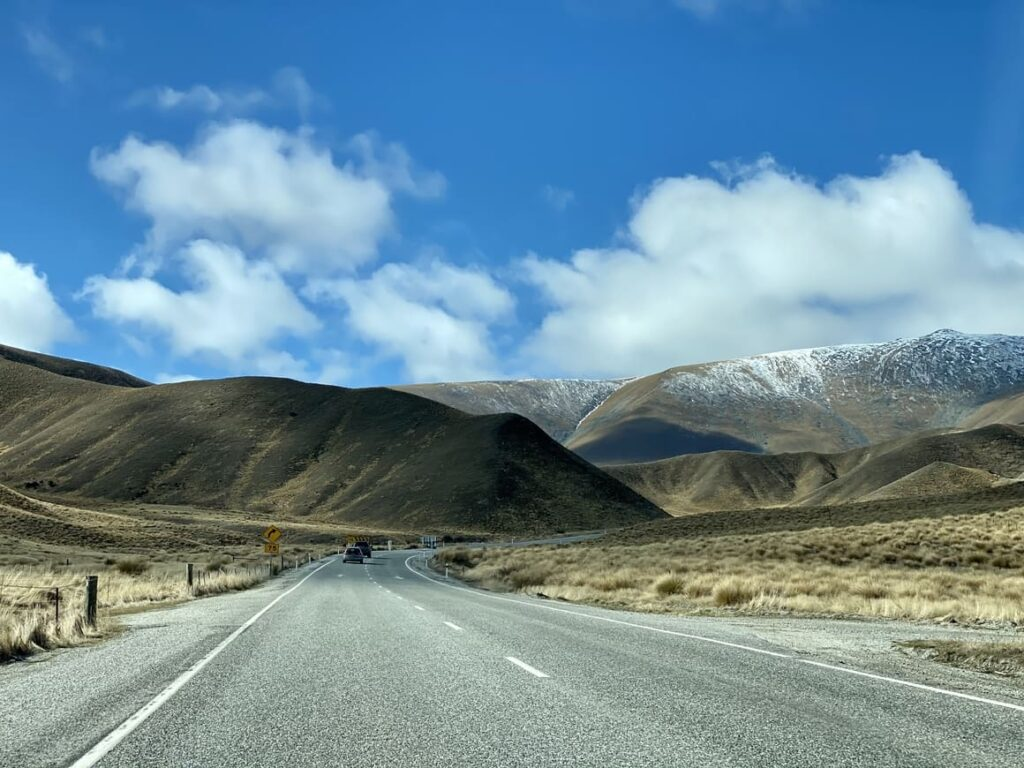 A road with mountains in the background in New Zealand