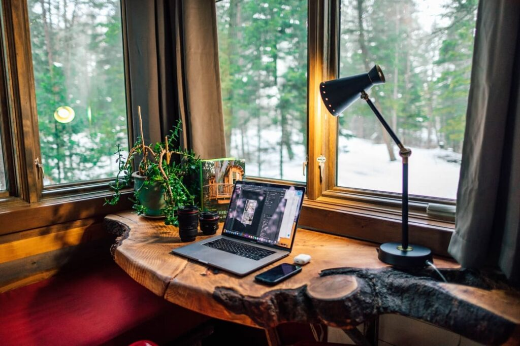 Computer on a desk with a lamp shining . Working from home tips