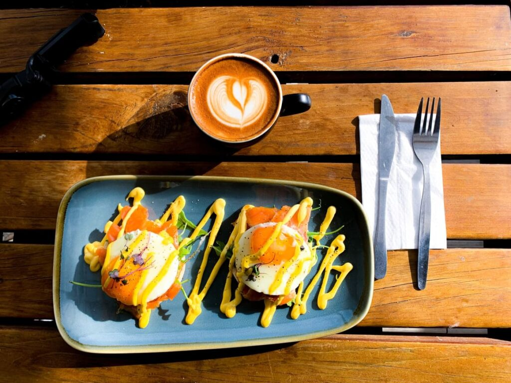 Plate of delicious looking food in nEw Zealand with a cup of coffee
