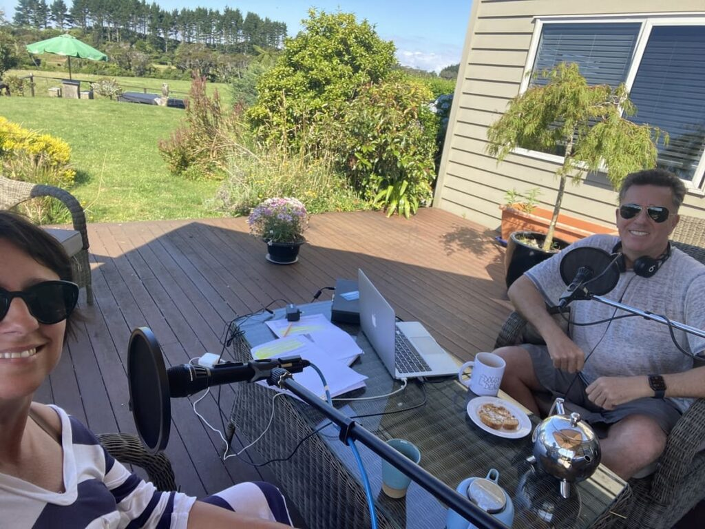 A husband and wife making a podcast episode in New Zealand