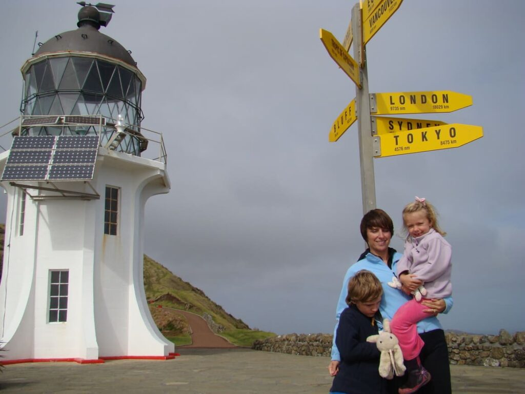 Family at a lighthouse in New Zealand. Making mistakes in New Zealand