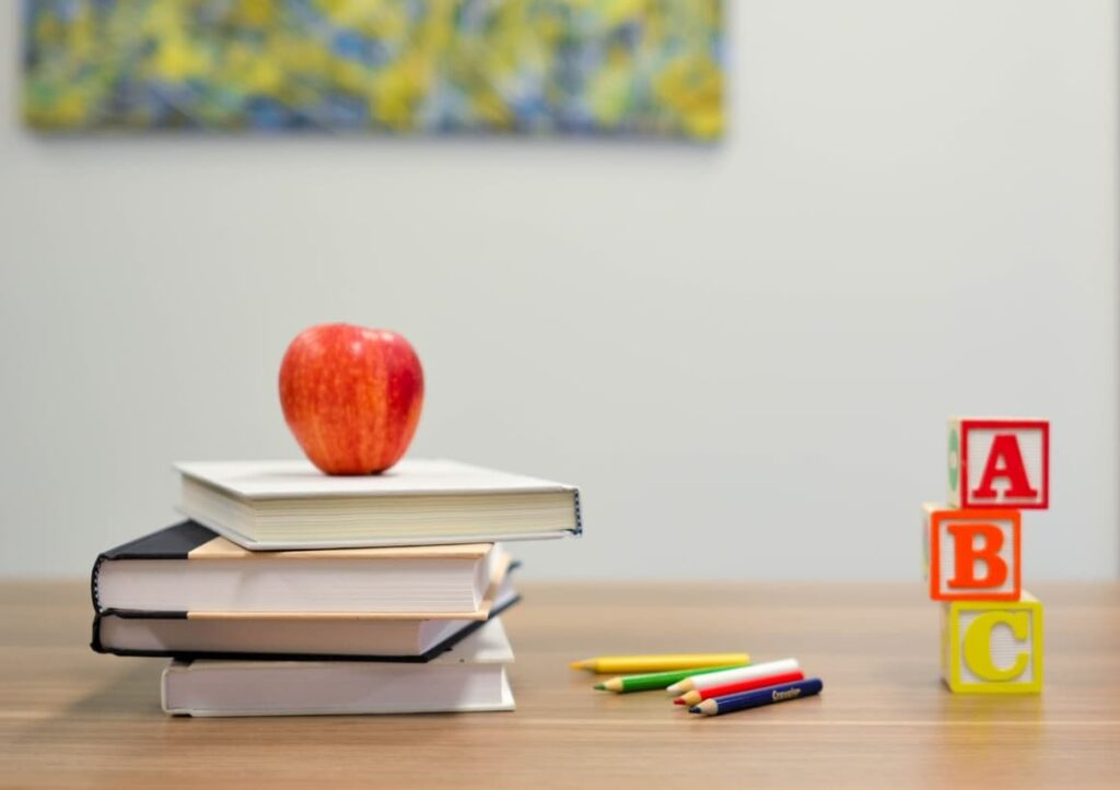 Book and an apple. Tips on home to start homeschooling