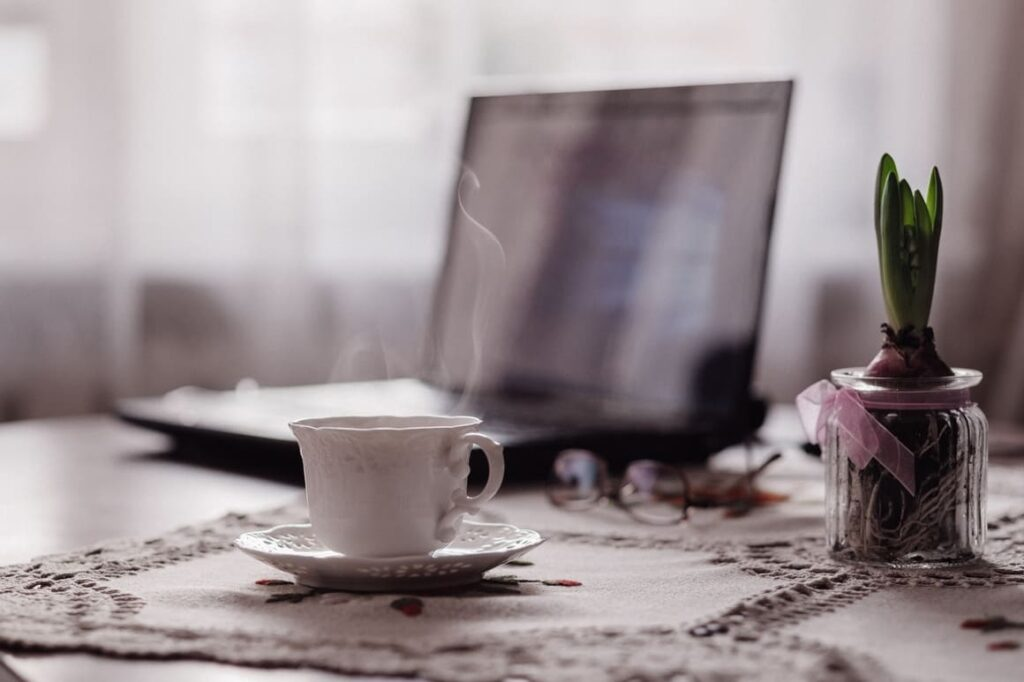 Computer and a cup of tea. Working from home tips