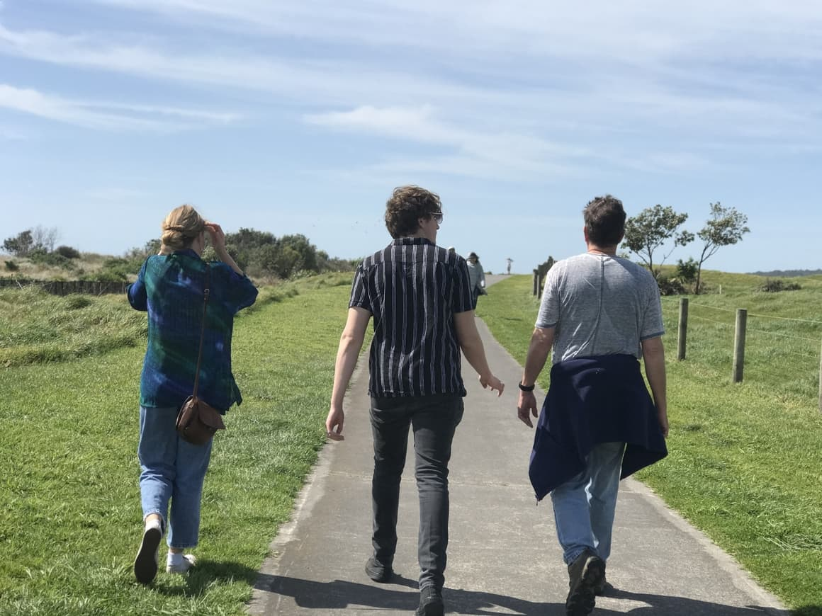 Family walking along a path in New Zealand