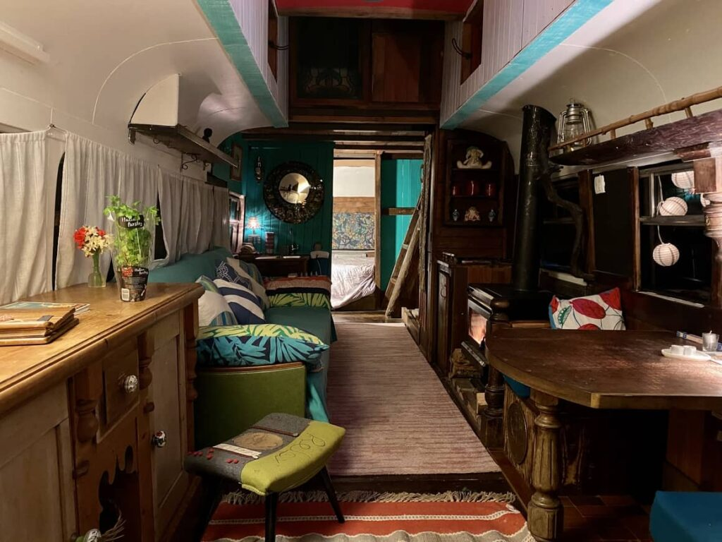 Inside a bus that is converted for glamping in new zealand