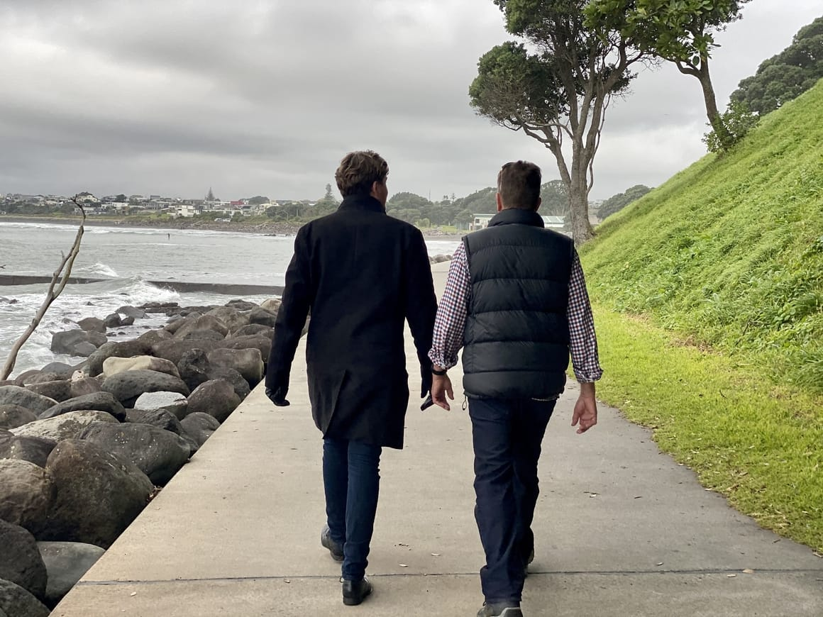 Man and son walking in New Zealand