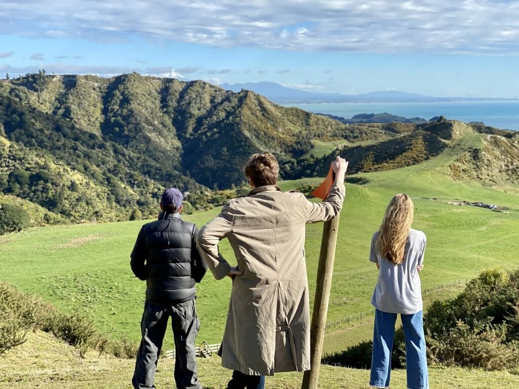 Family overlooking the hills in New Zealand