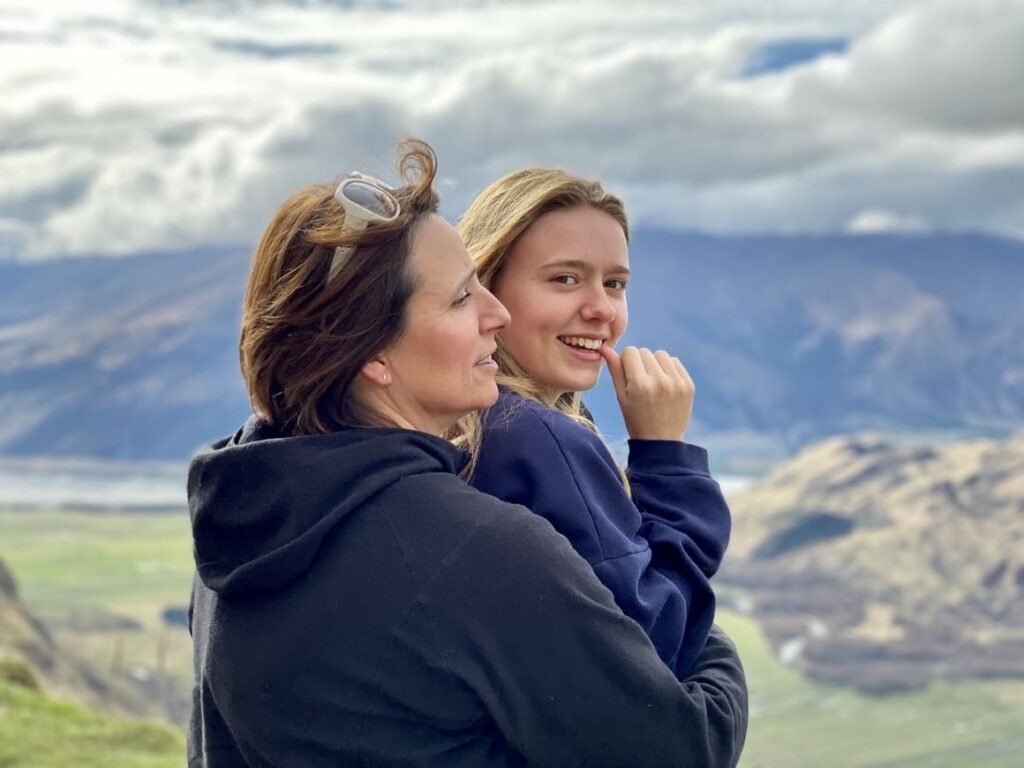 Mother and daughter standing looking at the view in New Zealand
