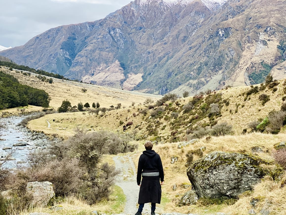 boy standing in valley in New zealand