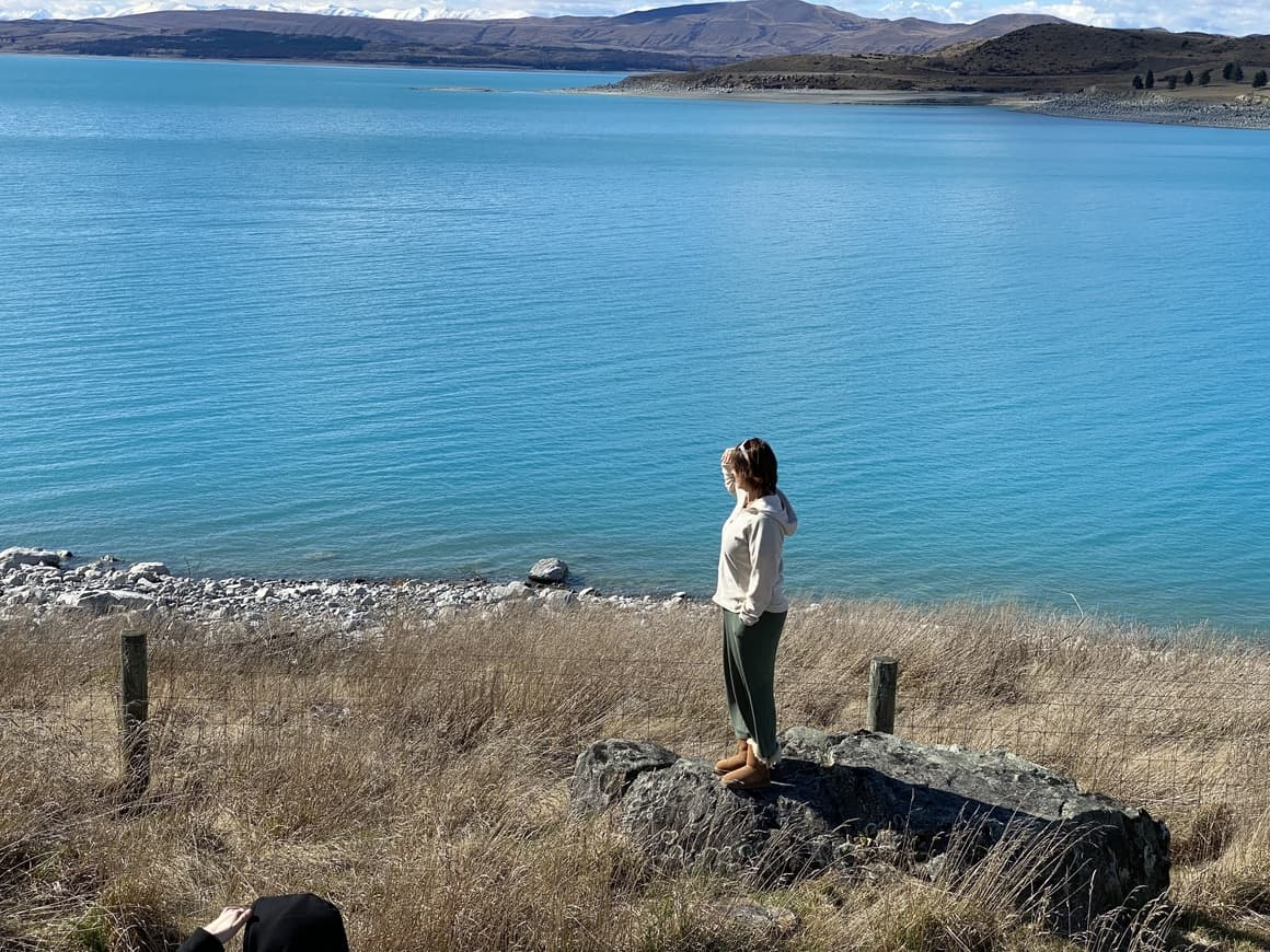 Woman standing at Lake in New Zealand