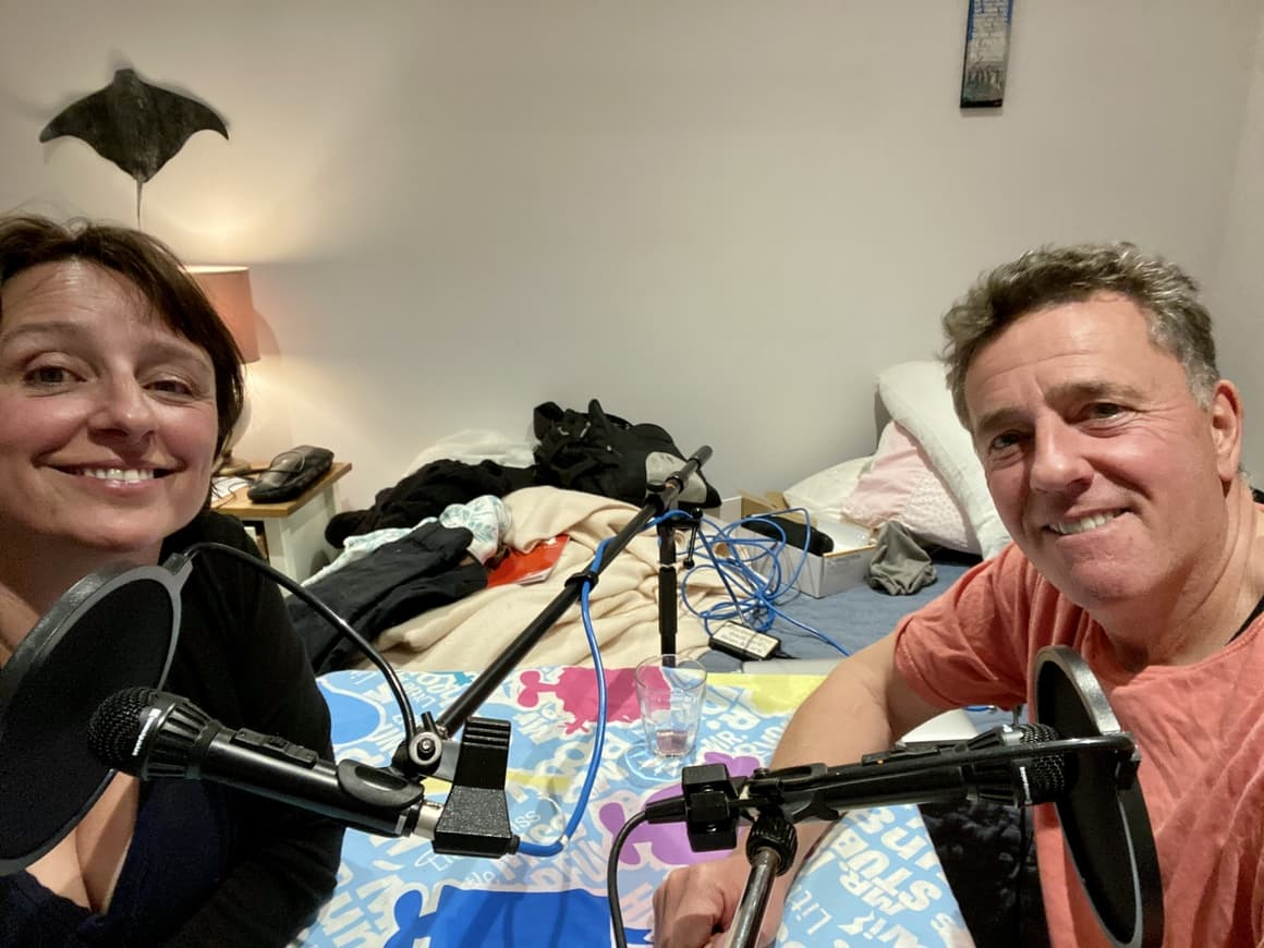 Husband and wife making a podcast episode