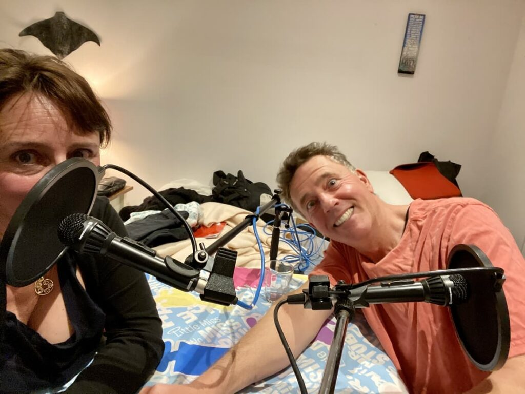 Husband and wife making a podcast episode together