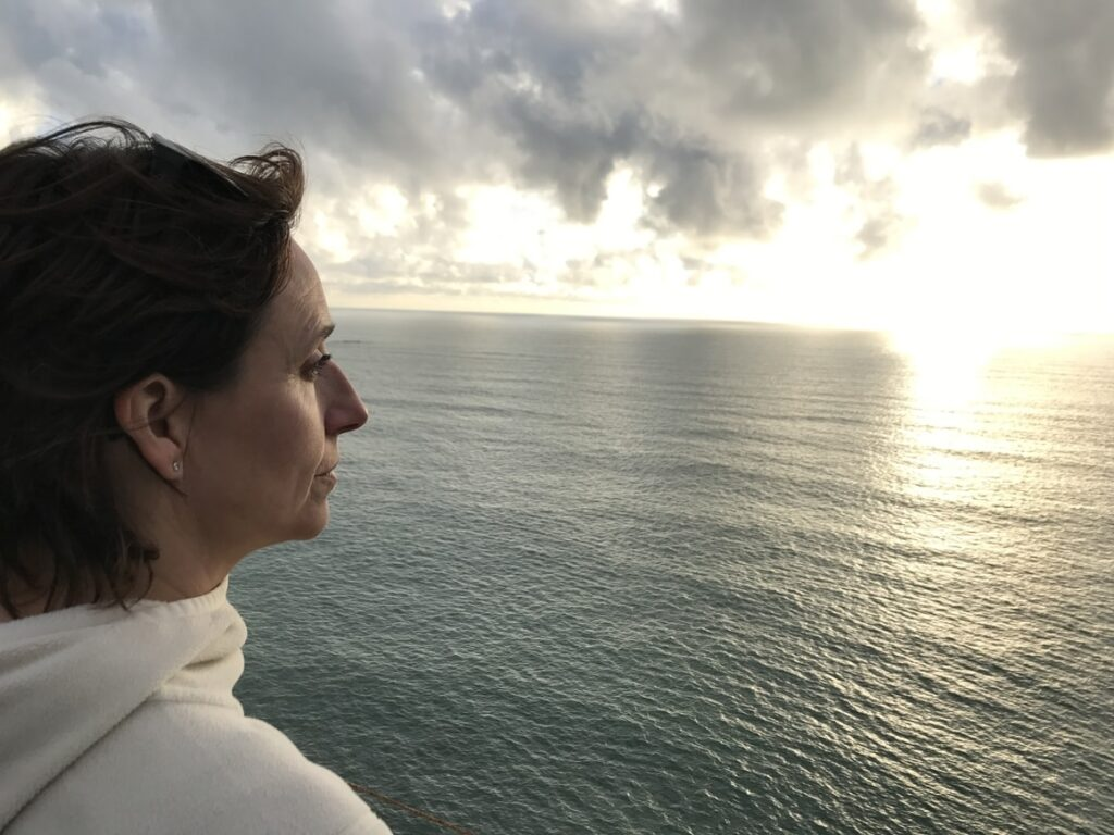 Woman looking over at the water in New Zealand