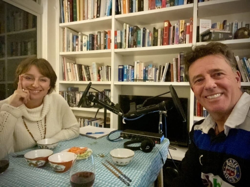Man and wife talking on their new Zealand podcast