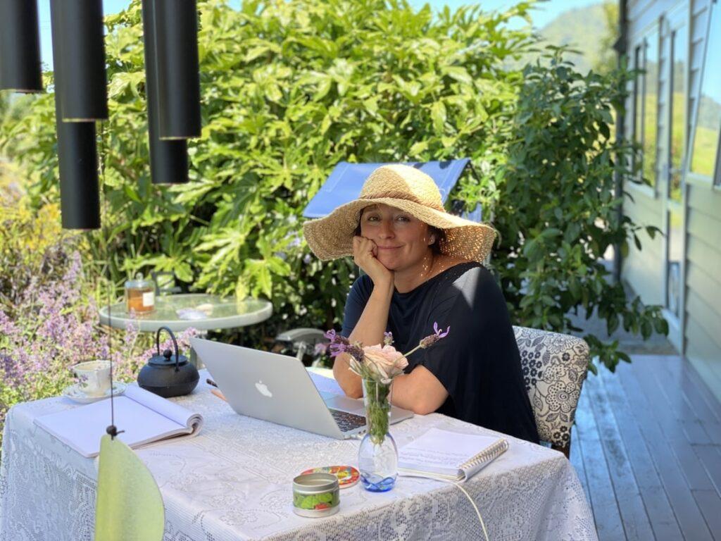 Woman writing a book in the garden