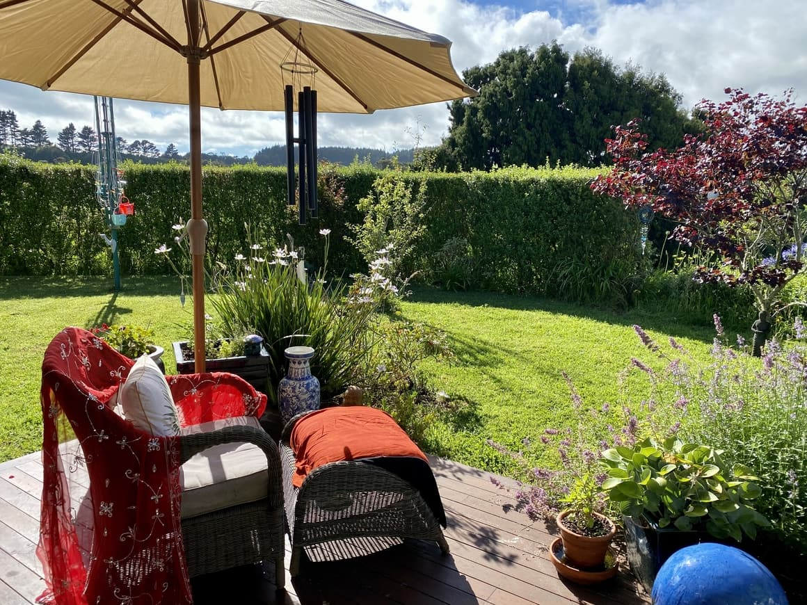 Garden view with a chair and parasol in New Zealand