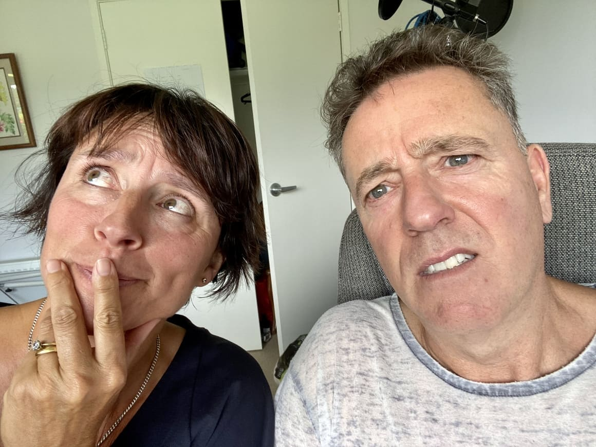 Man and woman looking confused as they don;t know whether to continue with their New Zealand podcast