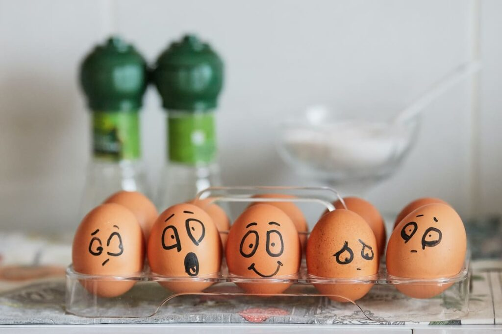 5 Eggs with faces drawn onto them. The pros and cons of homeschooling